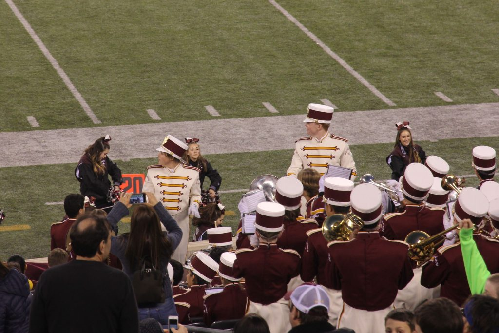 Brooke Maskin (Drum Major, left) and Teddy Trent (Field Captain, right), conduct the Ridgewood Marching Band.